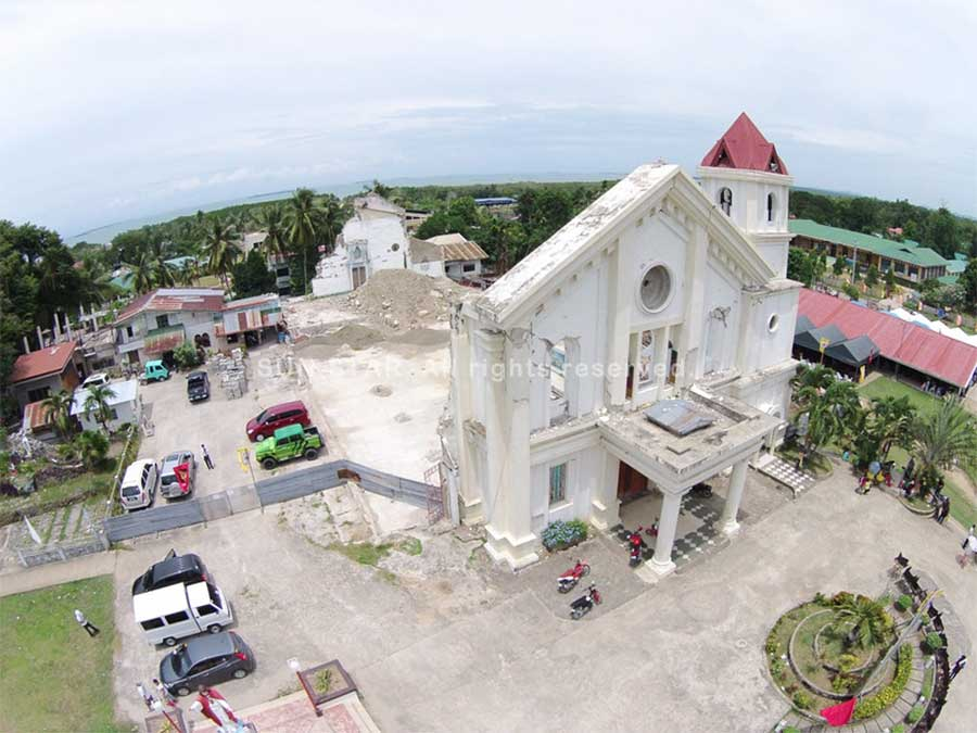 HELD TOGETHER. The facade of the St. Michael the Archangel Church in Clarin, Bohol remains intact. Everything behind it has fallen to pieces, but parishioners continue to worship in a tent on the church grounds. (Allan Cuizon)